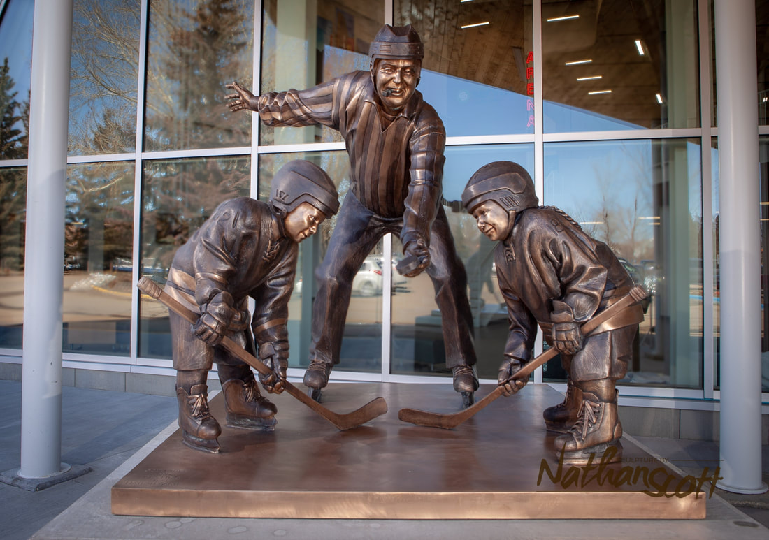 bronze hockey sculpture statue arena red deer alberta peewee timbits